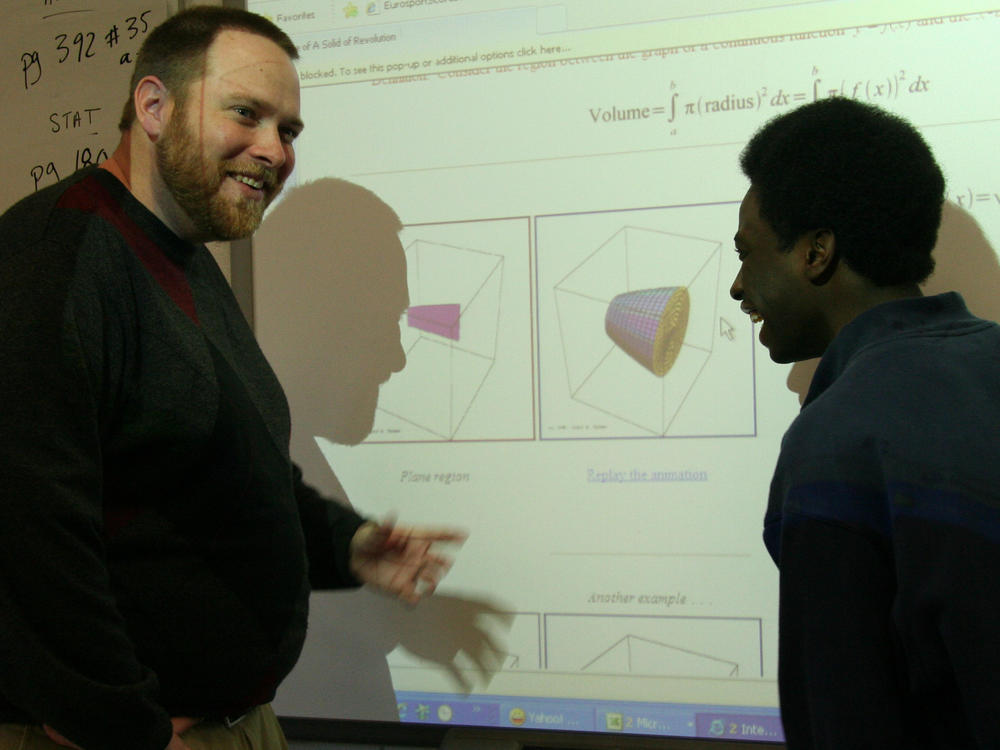 Chad Prosser at SMARTBoard with Student